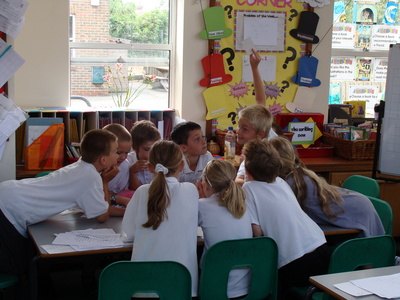 Pupils at Silverdale Primary School enjoying a kanji card game