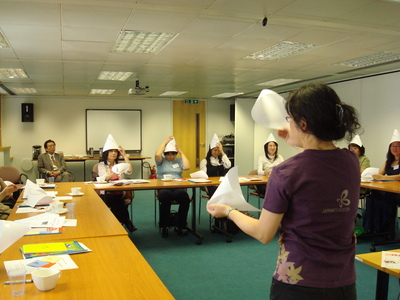 StepOutNet members wearing true and false hats as part of a quiz