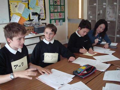 Year 7 students at Priory School trying Japanese with StepOutNet volunteer Asami Harada